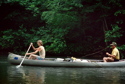 David and George paddle a canoe on the Eleven Point River. 1979.