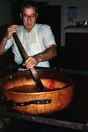 Kenneth Cunningham stirs a batch of hard candy in a copper kettle. Cunningham Candy Company. Springfield, Missouri. about 1971.