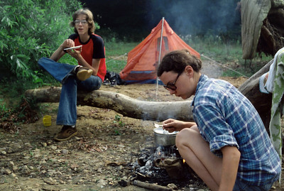 David and Rita around the camp fire on an overnight float. Eleven Point River, 1979.