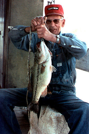 George Wright Sr shows off his fish. Location and date unknown, probably early 1970s. Not sure if this is my photo - can't find the original.