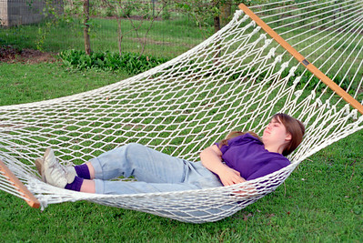 Olivia Morris in the hammock. Garden party at Ritas, Brookline, MO. About 1993?