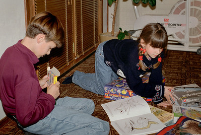 Jared and Kelsey play on the floor. Christmas at Cara's, 1997.