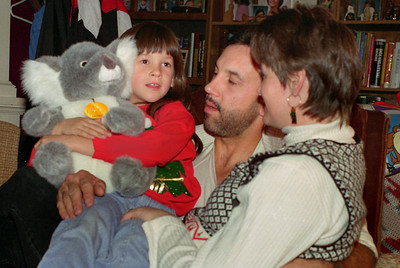 Kelsey with her stuffed toy, Kevin and Dana. Christmas at Normas, 1996.