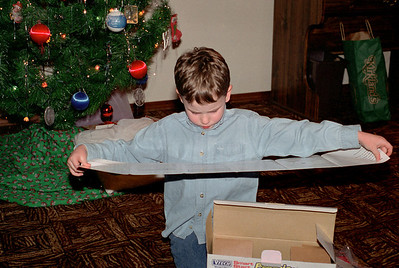 Jake reads the instructions. Christmas at Cara's, 1997.