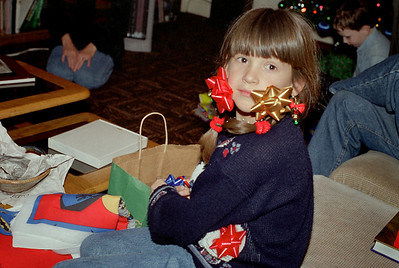 Kelsey with bows on. Christmas at Cara's, 1997.