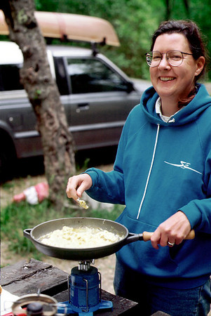 Rita cooking on her campground stove, 1997.