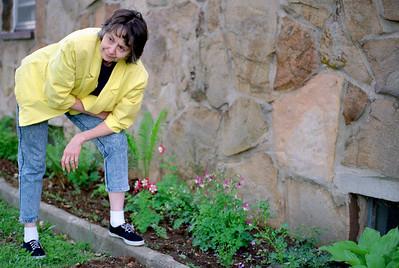 Norma admiring Rita's flowers; garden party at Ritas, Brookline, MO. About 1993?