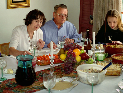 Norma, George and Jessca at the Thanksgiving table, Brookline, Mo, 1995.