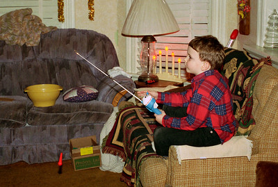 Jake with toy fishing rod. Christmas at Norma's, 1996.