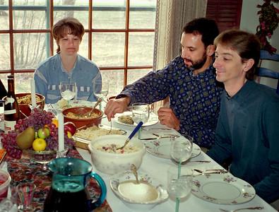 Dana, Kevin and David at the Thanksgiving table, Brookline, Mo, 1995.