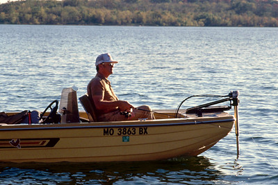 George Wright fishing from his motor boat sometime in the early 1990s.