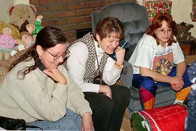 Rita, Dana and Lisa watch the chaos. Christmas at Normas, 1996.