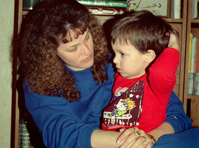 Dana and Jared Sanders. Christmas at Norma's, 1990.