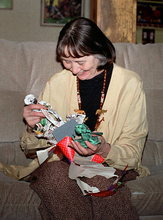 Norma unwraps her gift. Christmas at Cara's, 1997.