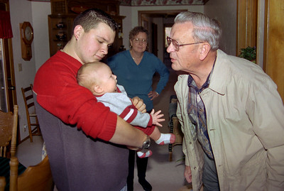 Wes Walker Sr, Baby Wes, and George Wright. Thanksgiving at Cara Russel's, 2002.
