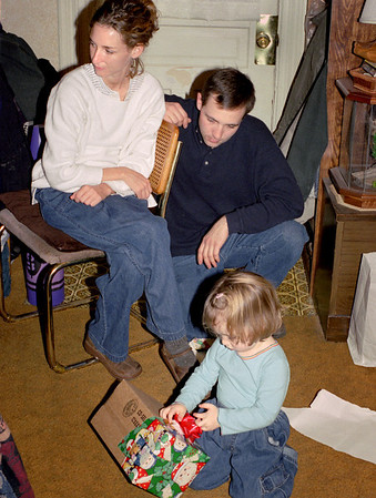 Jennifer and Sean Melton watch Hannah unwrap her present. Christmas at Norma's. 2001.
