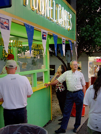 Norma and George getting some funnel cakes at the Ozark Empire Fair - July 2003.