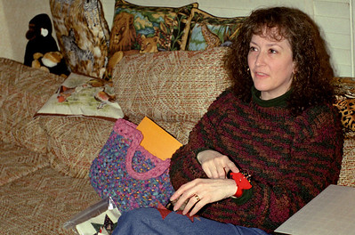 Cara explains her wrist pin cushion at Norma's. Spring, 2001.