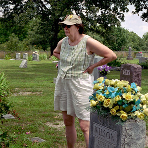 Norma standing among gravestones - geneology expedition, Summer 2004.