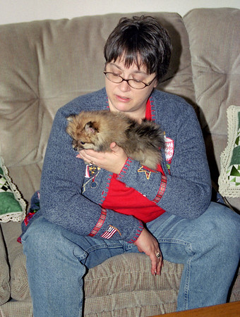 Lisa (Wright) Hendrix holding her little doggy; Thanksgiving at Cara's, 2002.