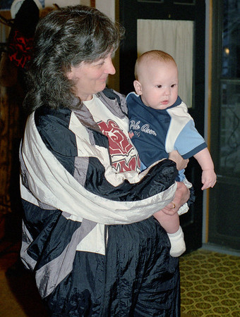 Cara Russel holding Baby Wes Walker at Norma's, Spring 2003.