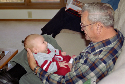 George holding Baby Wes Walker. Thanksgiving at Cara Russel's, 2002.