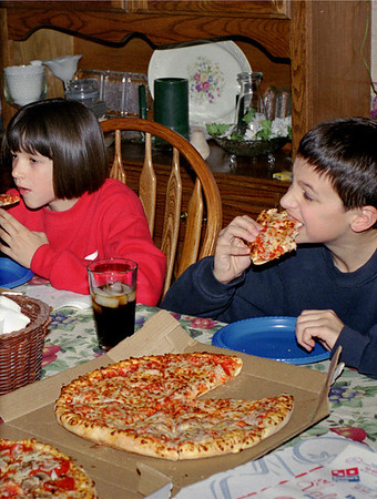 Kelsey and Jared eat pizza at Norma's. Spring, 2001.
