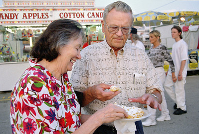 Norma and George Wright enjoying funnel cake at the Ozark Empire Fair - July 2003.