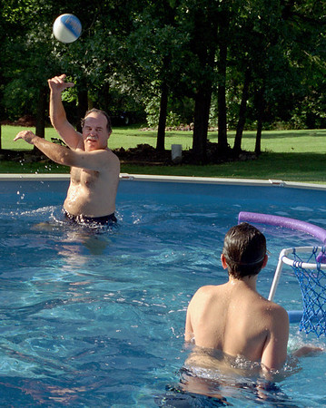 Larry and Jake play catch in Cara's pool. July, 2004.
