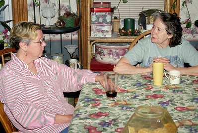 Rita and Norma at Norma's table, April 2003.