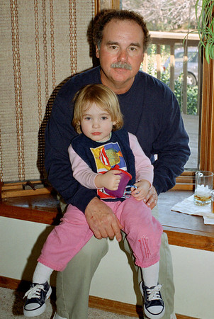 Larry Russell holding his grandaughter, Hannah Melton. Thanksgiving at Cara's, November 2001.