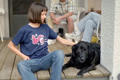 Kelsey Sanders petting Luke the dog at Norma's, Spring 2003.