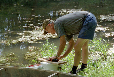 George Wright filleting fish, near Rock Eddy Bluff on the Gasconade River, late summer 2002.