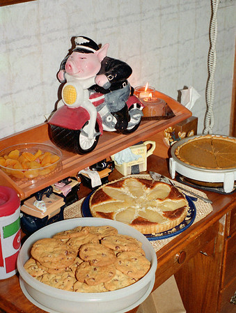 Desserts, and a pig on a motorcycle - one of Cara's many cookie jars - Thanksgiving at Cara's, November 2001.