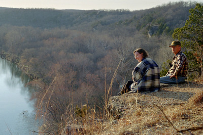 Rita and George on the edge of the bluffs,  Rock Eddy Bluff B&B near Rolla, Missouri. Spring, 2001.