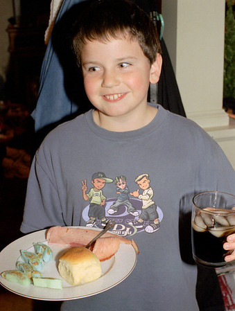 Jacob Wright and his Christmas plate at Norma's, December 2001.