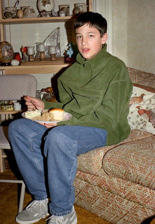 Jared Sanders eating Christmas dinner at Norma's, December 2001.