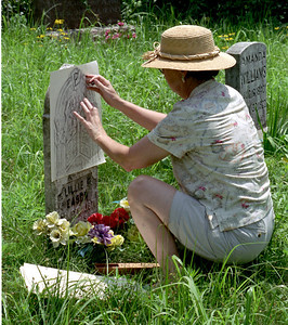 Rita makes a rubbing from a gravestone - geneology expedition, Summer 2004.