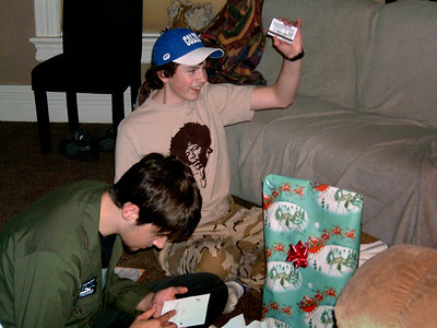 Jared and Jake raking in the loot. Christmas at Norma's, 2005.