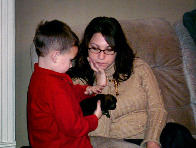 Young Wes shows a puppy to Jessica. Christmas at Norma's, 2006.
