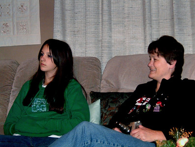 Kelsey and Dana watch the action. Christmas at Norma's, 2005.