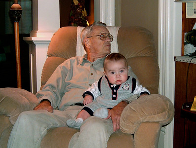 George and Simon in the recliner. George's 74th birthday Oct. 27, 2005.
