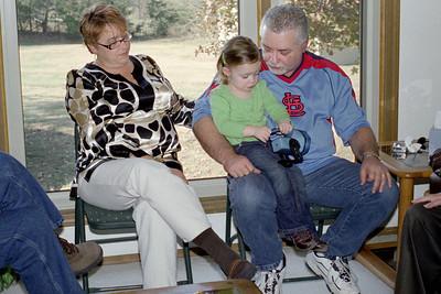Lisa and Keith hold young Ainsley. Thanksgiving 2008 at Cara's.