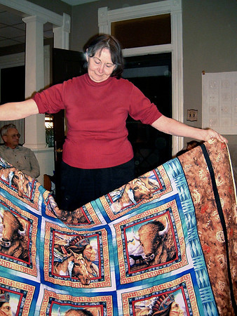 Norma displays one of her quillows. George's 74th birthday Oct. 27, 2005.