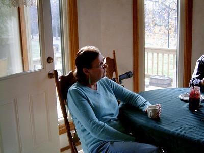 Rita at the table. Thanksgiving at Cara's, 2005.