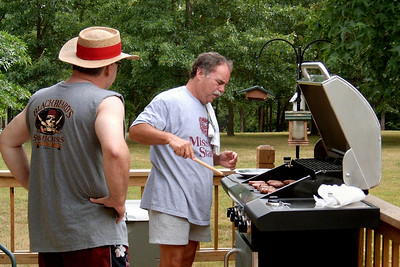 Keith Hendrix and Larry Russell at the grill. July 4th at Cara and Larry's, 2006.