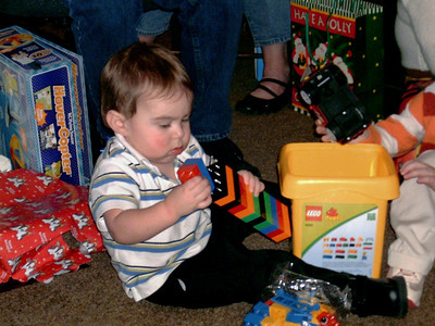 Simon plays with his new Legos. Christmas at Norma's, 2006. (File name is incorrect.)
