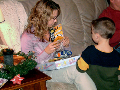 Jessica and Wes open gifts. Christmas at Norma's, 2005.