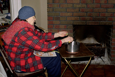 Norma, making soup  beside her fireplace. Ice storm, - January, 2007.