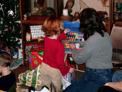 Hannah and Cara unwrap presents. Christmas at Norma's, 2005.